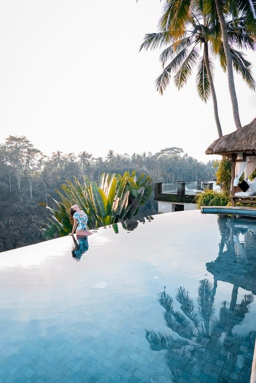 Girl sitting by the poolside at The Viceroy Bali