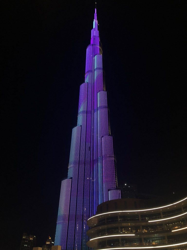 Burj Khalifa lit up in purple during light show in Dubai