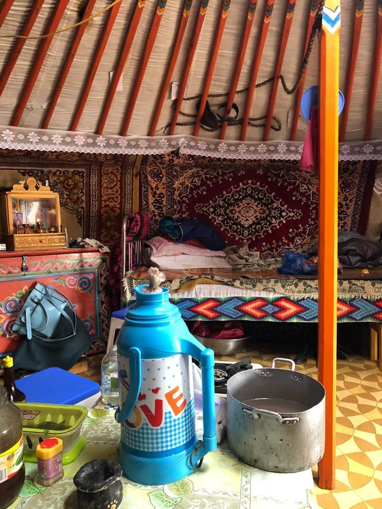 Inside a traditional Mongolian Yurt where carpets hang for insolation