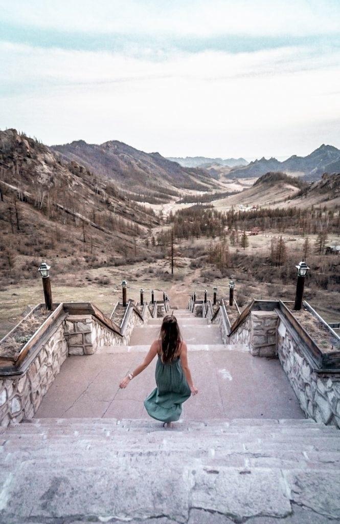 Girl running down stairs at Gorkhi-Trelej National Park in Mondolia