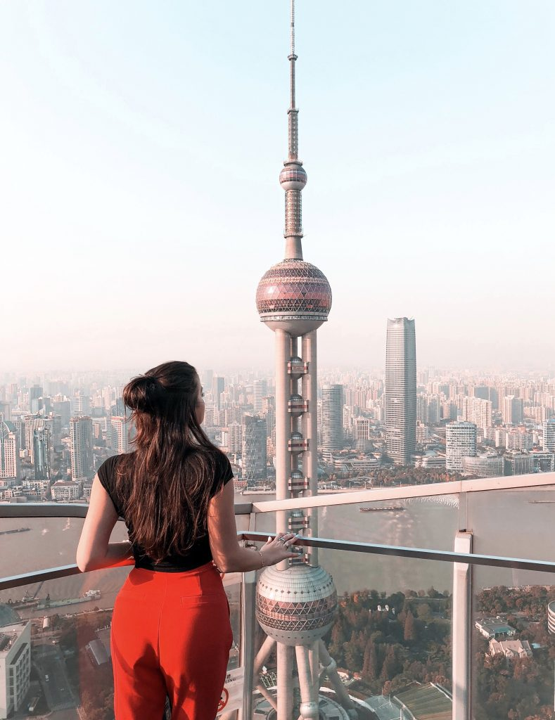 Elona Karafin looking at the view of the Oriental Pearl Tower from the top of the Ritz-Carlton Shanghai